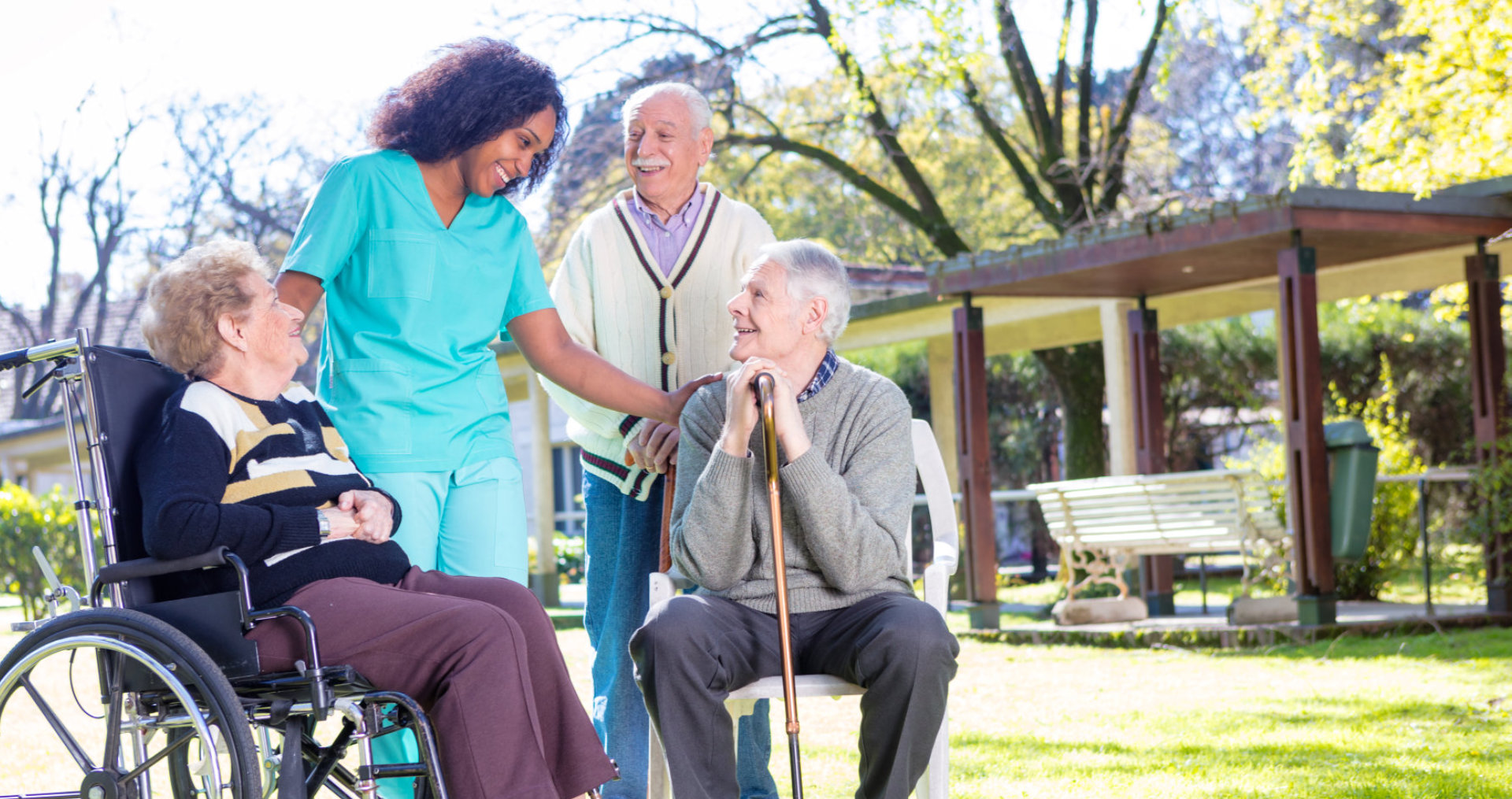 a caregiver talking with her senior patients
