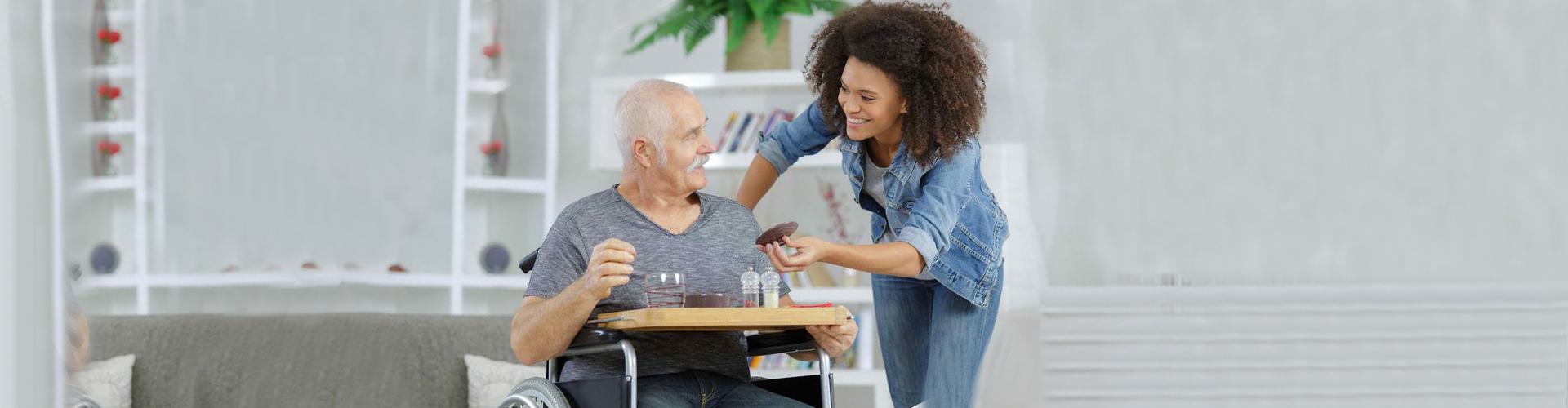 a happy smiling senior man and a caregiver