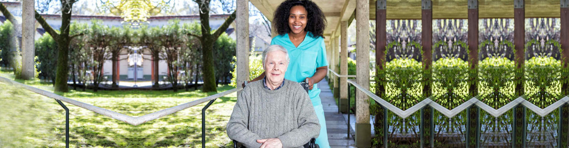 a caregiver and a senior man in wheelchair smiling